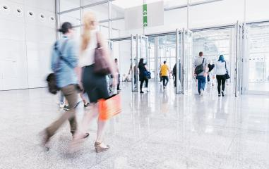 blurred visitors walking at trade fair hall- Stock Photo or Stock Video of rcfotostock | RC-Photo-Stock