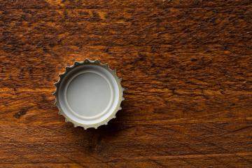bottle cap on wood- Stock Photo or Stock Video of rcfotostock | RC-Photo-Stock