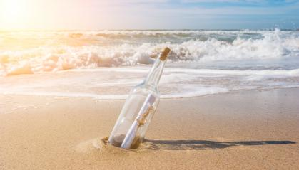 Bottle with the message at the ocean- Stock Photo or Stock Video of rcfotostock | RC-Photo-Stock