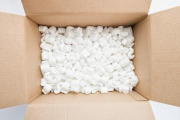 Box full of packing peanuts, uncluding copy space : Stock Photo or Stock Video Download rcfotostock photos, images and assets rcfotostock | RC-Photo-Stock.: