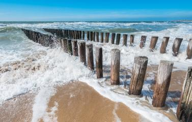 Breakwaters in with waves on the beach at the north sea- Stock Photo or Stock Video of rcfotostock | RC-Photo-Stock