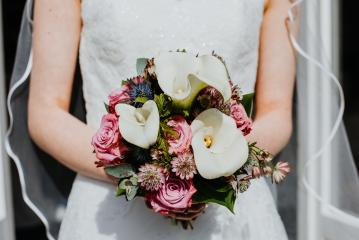 Bride is holding with her hands a wedding bouquet of flowers on her wedding day. Close-up of the beautiful natural flowers.  : Stock Photo or Stock Video Download rcfotostock photos, images and assets rcfotostock   RC-Photo-Stock.: