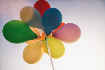 bright bunch of Colorful balloons at sunset- Stock Photo or Stock Video of rcfotostock | RC-Photo-Stock