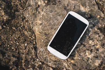 Broken Screen Smartphone on stone background- Stock Photo or Stock Video of rcfotostock | RC-Photo-Stock