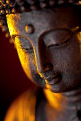 Buddha statue head close-up with glow against black background- Stock Photo or Stock Video of rcfotostock | RC-Photo-Stock