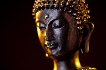 Buddha statue head close-up with glow against black background : Stock Photo or Stock Video Download rcfotostock photos, images and assets rcfotostock | RC-Photo-Stock.: