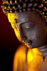 Buddha statue head with glow against black background : Stock Photo or Stock Video Download rcfotostock photos, images and assets rcfotostock | RC-Photo-Stock.: