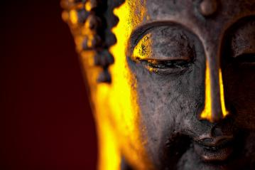 Buddha statue head with glow against black background, with copy space- Stock Photo or Stock Video of rcfotostock | RC-Photo-Stock
