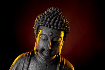 Buddha statue with glow against black background : Stock Photo or Stock Video Download rcfotostock photos, images and assets rcfotostock | RC-Photo-Stock.: