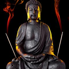 Buddha statue with glow and incense sticks against black background : Stock Photo or Stock Video Download rcfotostock photos, images and assets rcfotostock | RC-Photo-Stock.: