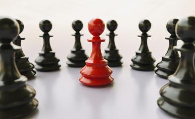 bullying; concept, red pawn of chess, standing out from the crowd of blacks- Stock Photo or Stock Video of rcfotostock | RC-Photo-Stock