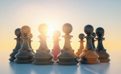 bullying concept, red pawn of chess, standing out from the crowd of blacks with sunflare- Stock Photo or Stock Video of rcfotostock | RC-Photo-Stock