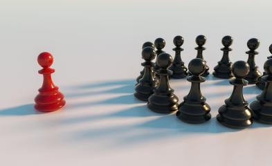 bullying concept, red pawn of chess, standing out from the crowd of blacks- Stock Photo or Stock Video of rcfotostock | RC-Photo-Stock