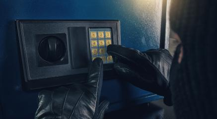 Burglar enter a code to crack a safe : Stock Photo or Stock Video Download rcfotostock photos, images and assets rcfotostock | RC-Photo-Stock.: