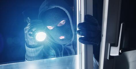 Burglar entering to house trough a window at night- Stock Photo or Stock Video of rcfotostock | RC-Photo-Stock