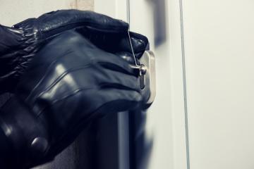 burglar hands holding Lock picker to open a victim's home door- Stock Photo or Stock Video of rcfotostock | RC-Photo-Stock