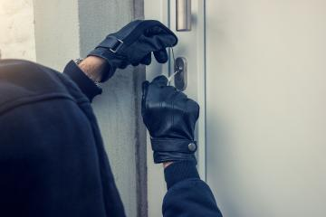 burglar holding Lock-picker to open a housedoor- Stock Photo or Stock Video of rcfotostock | RC-Photo-Stock
