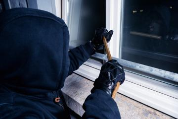 burglar opens a window with a crowbar at night- Stock Photo or Stock Video of rcfotostock | RC-Photo-Stock