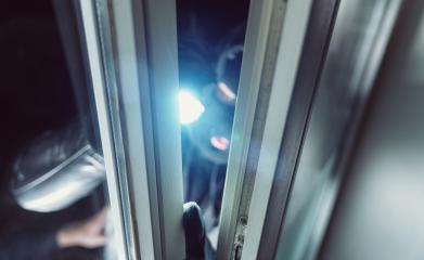 Burglar shines with flashlight in to a window of a house at night : Stock Photo or Stock Video Download rcfotostock photos, images and assets rcfotostock | RC-Photo-Stock.: