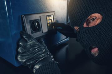 Burglar tries to find the combination code of a safe  : Stock Photo or Stock Video Download rcfotostock photos, images and assets rcfotostock | RC-Photo-Stock.: