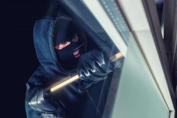 burglar using crowbar to break into a house window at night - Stock Photo or Stock Video of rcfotostock | RC-Photo-Stock