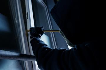burglar using crowbar to break into a victim's house window- Stock Photo or Stock Video of rcfotostock | RC-Photo-Stock