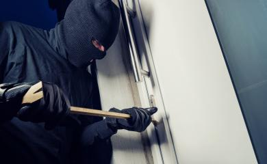 Burglar wearing black clothes and breaking in a house at night- Stock Photo or Stock Video of rcfotostock | RC-Photo-Stock