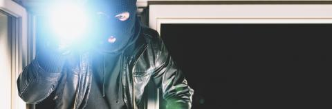 Burglar with crowbar and flashlight, with copy space, banner size : Stock Photo or Stock Video Download rcfotostock photos, images and assets rcfotostock | RC-Photo-Stock.:
