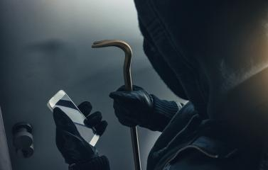 burglar with crowbar and smartphone preparing burglary via smart home app : Stock Photo or Stock Video Download rcfotostock photos, images and assets rcfotostock | RC-Photo-Stock.: