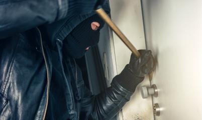 burglar with crowbar breaking and entering a house door at night : Stock Photo or Stock Video Download rcfotostock photos, images and assets rcfotostock | RC-Photo-Stock.:
