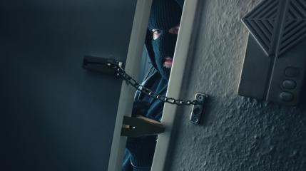 burglar with crowbar breaking into a victim's home door with chain : Stock Photo or Stock Video Download rcfotostock photos, images and assets rcfotostock | RC-Photo-Stock.: