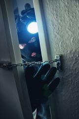 burglar with flashlight breaking and entering into a victim's home door  : Stock Photo or Stock Video Download rcfotostock photos, images and assets rcfotostock | RC-Photo-Stock.: