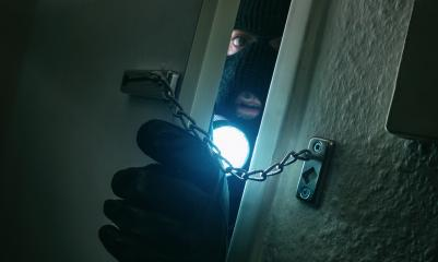 burglar with flashlight breaking into a victim's home at night : Stock Photo or Stock Video Download rcfotostock photos, images and assets rcfotostock | RC-Photo-Stock.: