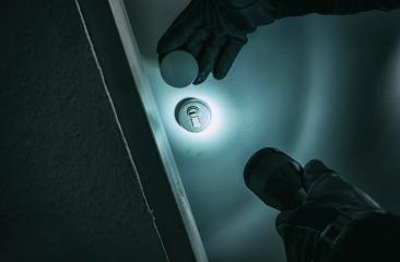 burglar with leather gloves and torch opens a home door : Stock Photo or Stock Video Download rcfotostock photos, images and assets rcfotostock | RC-Photo-Stock.: