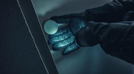 burglar with leather gloves and torch opens a victim's door at Night : Stock Photo or Stock Video Download rcfotostock photos, images and assets rcfotostock | RC-Photo-Stock.: