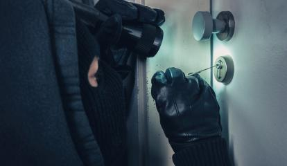 Burglar with lock picking tools and flashlight breaking into a house door : Stock Photo or Stock Video Download rcfotostock photos, images and assets rcfotostock | RC-Photo-Stock.: