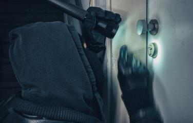 Burglar with lock picking tools breaking into a house door : Stock Photo or Stock Video Download rcfotostock photos, images and assets rcfotostock | RC-Photo-Stock.: