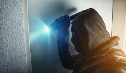 burglar with torch breaking and entering house door at night : Stock Photo or Stock Video Download rcfotostock photos, images and assets rcfotostock | RC-Photo-Stock.: