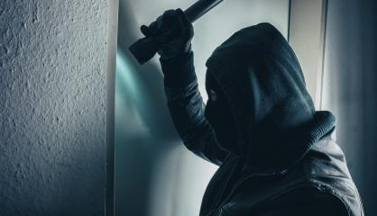 burglar with torch breaking and entering into a victim's home  : Stock Photo or Stock Video Download rcfotostock photos, images and assets rcfotostock | RC-Photo-Stock.: