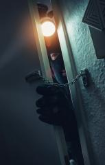 burglar with torch entering a door with chain at night : Stock Photo or Stock Video Download rcfotostock photos, images and assets rcfotostock | RC-Photo-Stock.: