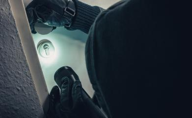 burglar with torch entering into a house door  : Stock Photo or Stock Video Download rcfotostock photos, images and assets rcfotostock | RC-Photo-Stock.:
