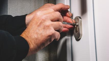 Burglars crack the front door with lock picking- Stock Photo or Stock Video of rcfotostock | RC-Photo-Stock