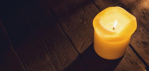 Burning candle over wooden background, elegant low-key shot- Stock Photo or Stock Video of rcfotostock | RC-Photo-Stock
