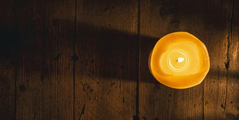 Burning candle over wooden background, elegant low-key shot, including copy space- Stock Photo or Stock Video of rcfotostock | RC-Photo-Stock