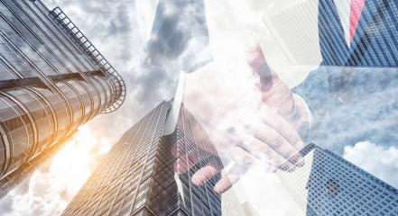 business handshaking process after a good deal. double exposure skyscraper on the background : Stock Photo or Stock Video Download rcfotostock photos, images and assets rcfotostock | RC-Photo-Stock.: