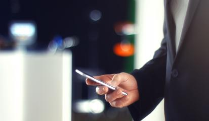 Business Man using Mobile Phone in Office- Stock Photo or Stock Video of rcfotostock | RC-Photo-Stock