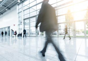business man walk to the trade fair - Stock Photo or Stock Video of rcfotostock | RC-Photo-Stock