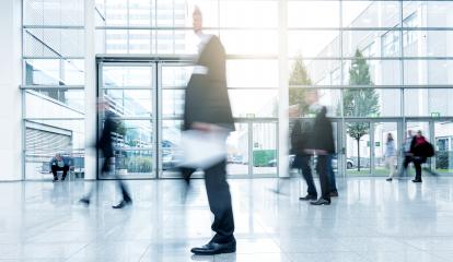 business people activity standing and walking at the trade fair motion blurred- Stock Photo or Stock Video of rcfotostock | RC-Photo-Stock