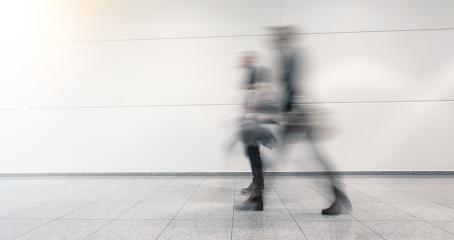 business people goes along a corridor - Stock Photo or Stock Video of rcfotostock | RC-Photo-Stock