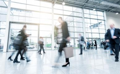 business people standing and walking on a trade fair floor- Stock Photo or Stock Video of rcfotostock | RC-Photo-Stock